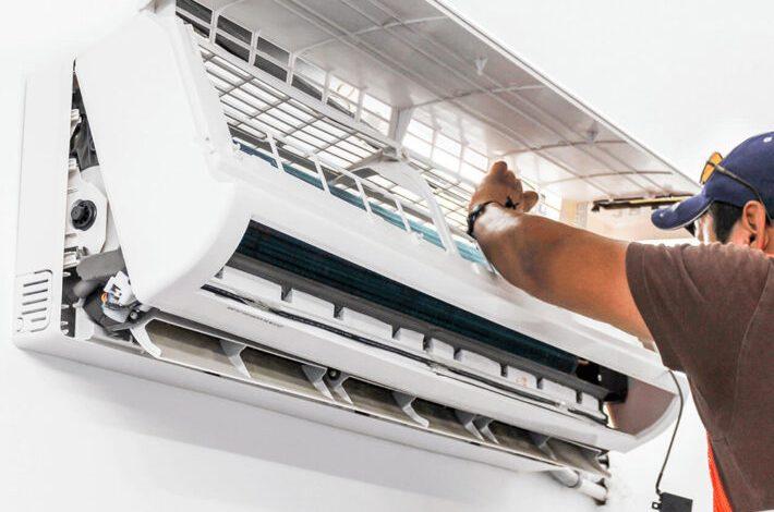 A man fixing an AC